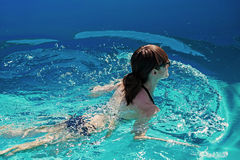 Young girl swimming in the pool Stock Photo