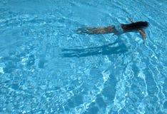 Girrl swimming in a pool Stock Photo
