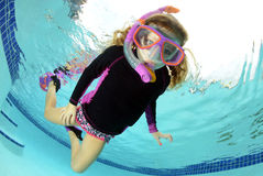 Young girl swimming underwater Stock Photos