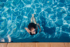Girl Pool Underwater Surfacing  Royalty Free Stock Photography