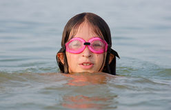 Young girl swimming in water Stock Images