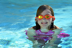 Young Girl Swimming With Goggles Royalty Free Stock Images