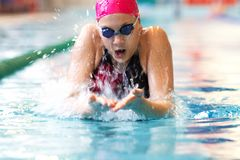 Young girl swims breaststroke Stock Photography
