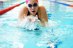 Young girl swims breaststroke stock photos