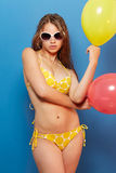 Young girl in swimsuit with balloons Royalty Free Stock Photo