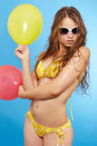 Young girl in swimsuit with balloons Royalty Free Stock Images