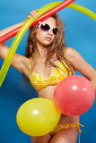 Young girl in swimsuit with balloons Royalty Free Stock Image