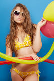 Young girl in swimsuit with balloons Stock Photography
