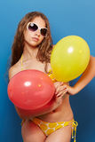 Young girl in swimsuit with balloons Royalty Free Stock Photos