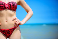 Young girl in swimsuit at ocean beach Stock Photo