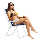 Young girl in swimsuite on chair with coctail Stock Images