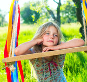 Young girl on swing Stock Images