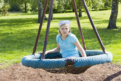Young girl on swing Royalty Free Stock Photos