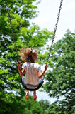 Young Girl on a swing Stock Photo