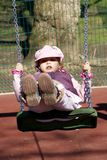 Young girl on swing Royalty Free Stock Photo