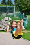 Young girl swinging stock image