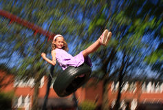 Young girl swinging royalty free stock photo