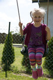 Young girl swinging at backyard Royalty Free Stock Photos