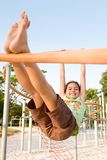 Young girl swinging on a bar Stock Photos