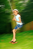 Young girl swinging fast Royalty Free Stock Images