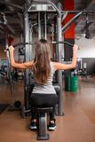 Young girl swinging in the gym. stock images