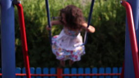 Young girl swinging stock video