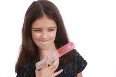 Young girl and syringe Stock Image