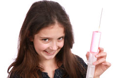 Young girl and syringe Stock Photography