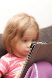 Young girl with tablet Stock Images