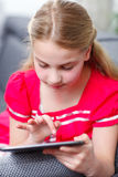 Young girl with tablet Royalty Free Stock Images
