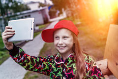 Young girl with a tablet in the park. Royalty Free Stock Photography