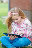 Young girl with tablet Royalty Free Stock Photography