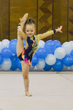 Young girl takes part in gymnastics competition Royalty Free Stock Photography