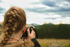 A young girl takes pictures of the forest. Young girl takes pictures of the forest Stock Image