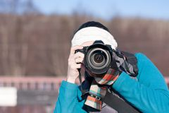 Young girl takes pictures of nature. Royalty Free Stock Images