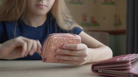 Young girl taking cash money from wallet in home room. Close up teenager girl hands putting money banknote in shine stock video