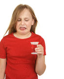 Young girl taking medicine Stock Photography