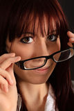 Young girl taking off glasses Stock Photo