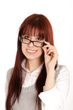 Young girl taking off glasses Stock Photos