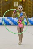 Young girl is taking part in a gymnastics competition Stock Photography