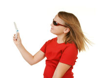 Young girl taking phone with phone Stock Photography