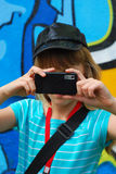 Young girl taking photo with mobile phone Stock Photography