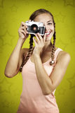 Young girl taking photo with retro camera Stock Photos