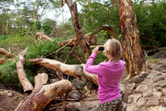 Young girl is taking photo on safari in Kenya royalty free stock image