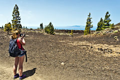 Young girl taking photo in Tenerife national park Stock Photo