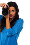 Young girl taking photos Stock Images