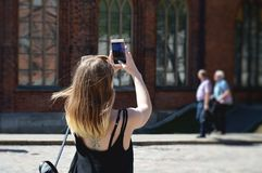 Young Girl Taking Photos Of City With Mobile Smart Phone royalty free stock photography