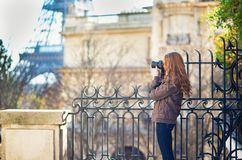 Young girl taking picture of the Eiffel tower Stock Photography