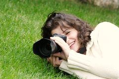 Young girl taking picture on nature Stock Image