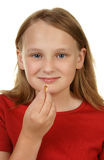 Young girl taking a pill Royalty Free Stock Photos